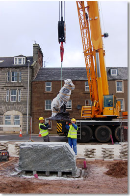 Crane lowers the statue to its place in Montrose